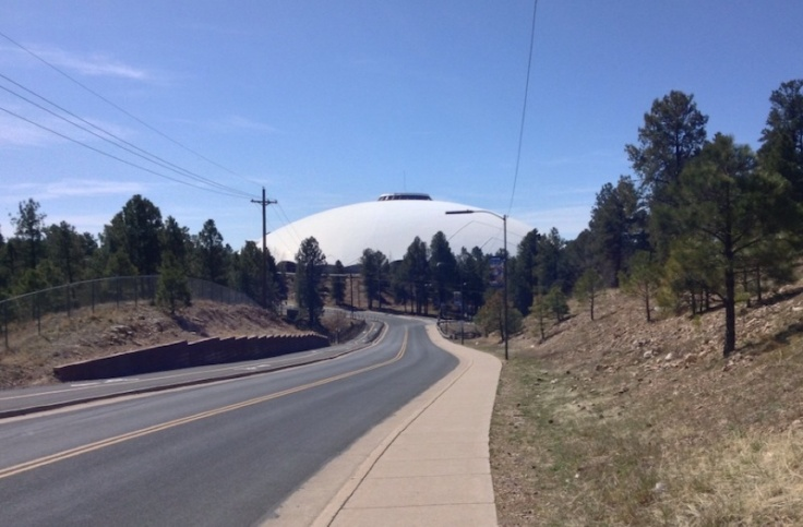 The bubble of the NAU skydome sticks up above trees