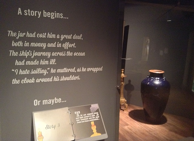 """Exhibit text: A story begins... The jar had cost him a great deal, both in money and in effort. The ship's journey across the ocean had made him ill. """"I hate sailing,"""" he muttered, as he wrapped the cloak around his shoulders."""