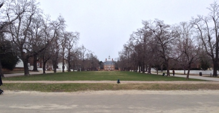 Long grassy area bordered by trees, on the approach to the Governor's Palace