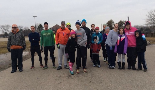Group photo of participants at Livonia parkrun - 18 people, well wrapped up against the cold