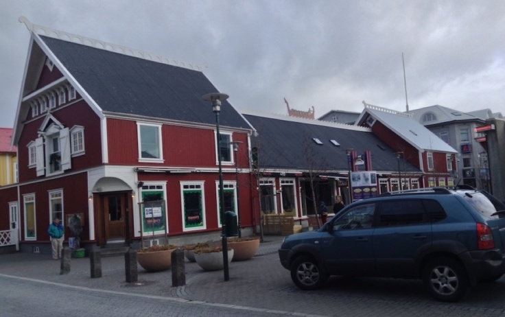 Low Icelandic houses, with a longboat silhouette on top