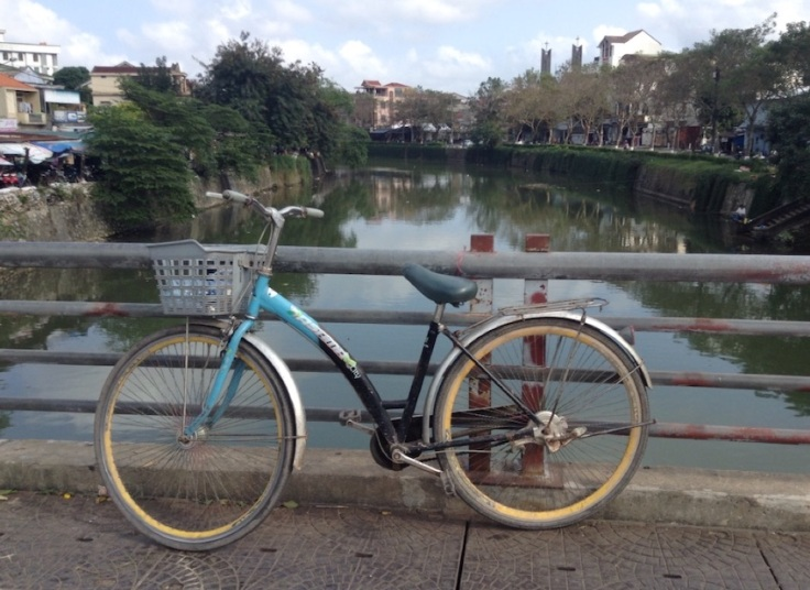 My shopper bike, parked on a bridge over a river