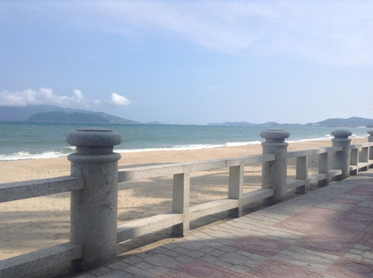 Nha Trang beachfront, with an almost empty beach in the heat