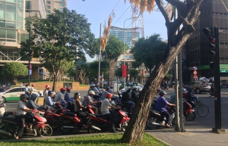 A queue of motor bikes makes for a busy street