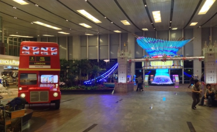 Inside the airport, exhibits in a London theme, including a double-decker bus