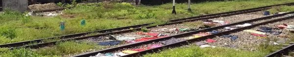 Clothes drying on the railway tracks