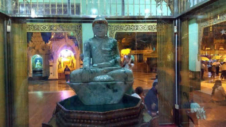 Jade Buddha behind glass