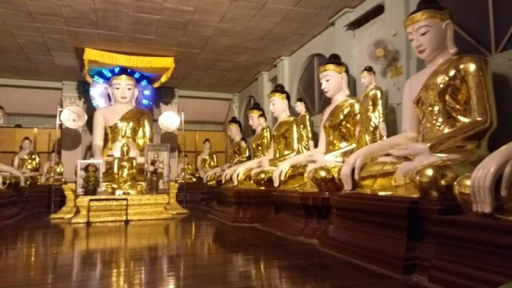 Gold Buddhas in a row