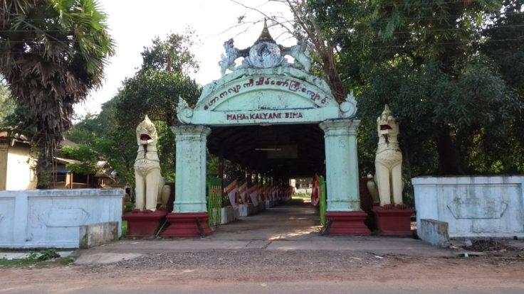 Lion sculptures flank a gate