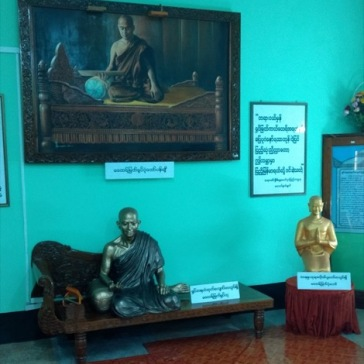 Buddha statues and painting in the cultural centre.