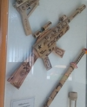 Bamboo toys. Guns marked with 'USA'