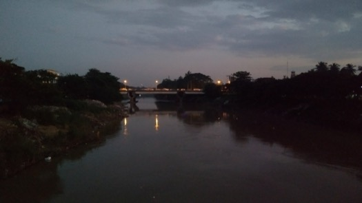 A bridge over a river, as the light fades from the day