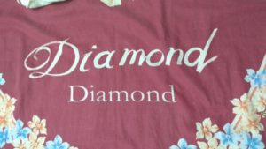 Bedsheet has the word Diamond, twice.