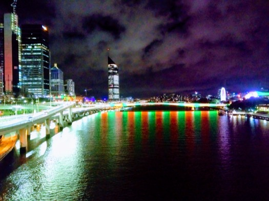 Brisbane by night, with red and green stripes on the water