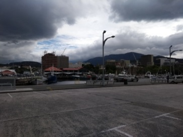 Hobart waterfront, under cloud and occasional sun.