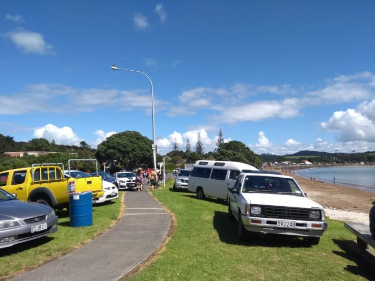 Cars parked everywhere for Waitangi Day, Waitangi beach, Paihia.