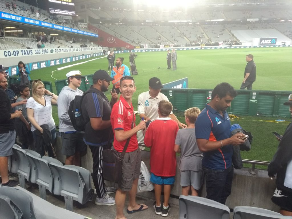 A small crowd queueing for autographs from the New Zealand team