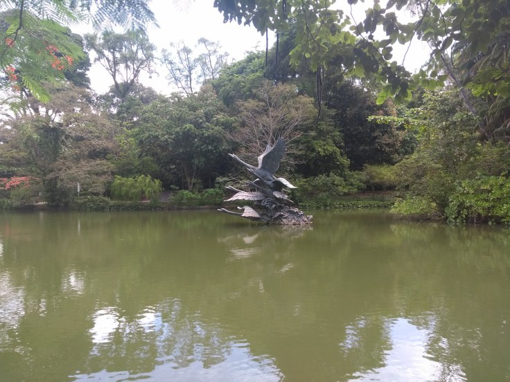 Swan Lake, with a sculpture of swans in the middle.