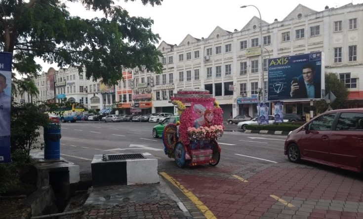 Bright Hello Kitty decorated cycle rickshaw.