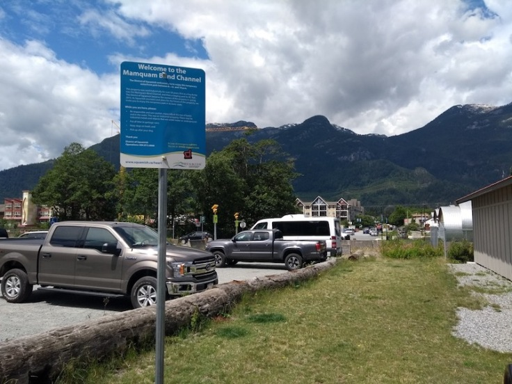 Car park overlooked by mountains