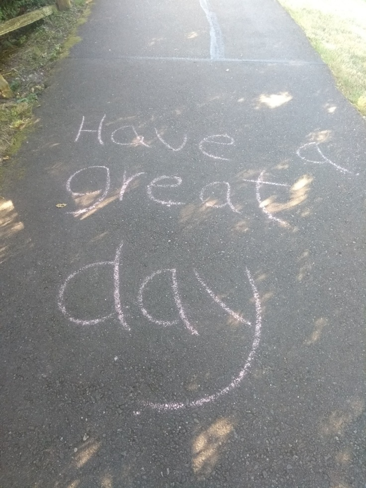 """Have a great day"" written in chalk"