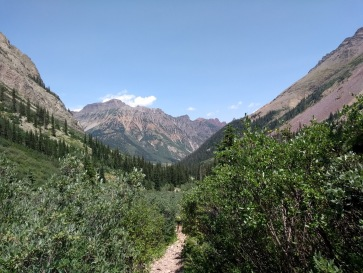 Valley and mountains, trail in the middle
