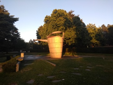 Watering can sculpture by sunset