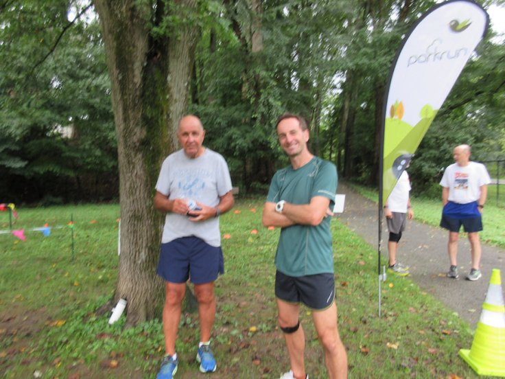Ron and me, by the parkrun flag and turnaround cone