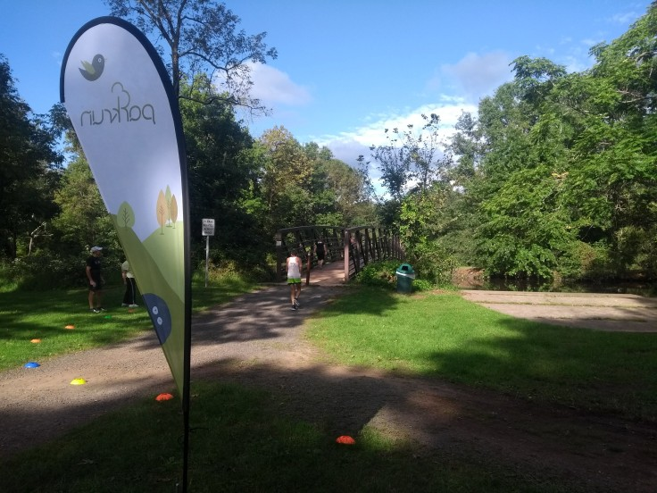 The bridge, parkrun flag to the foreground. Finish is to the right.