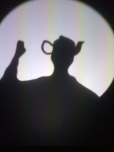 Backlit shadow puppetry