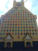 Borough badges, side of a building