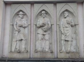 Bas relief of three men