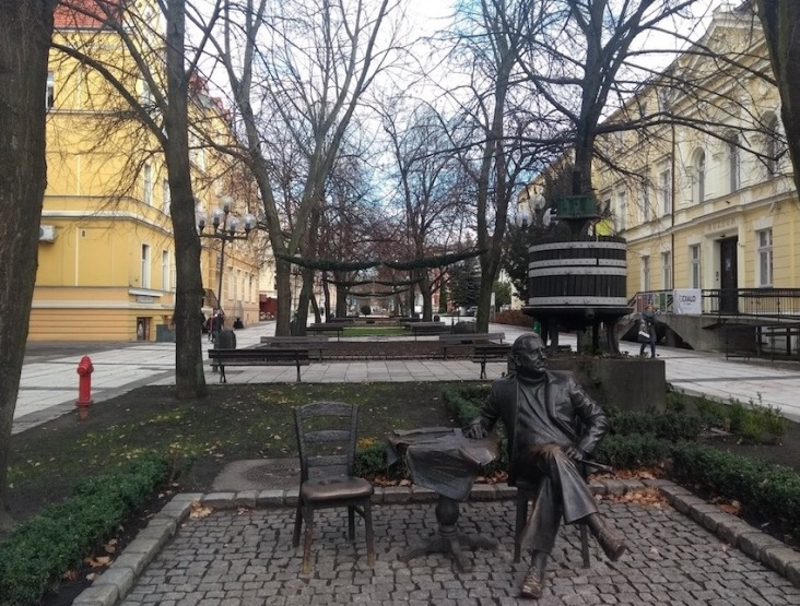 Statue of man, sitting