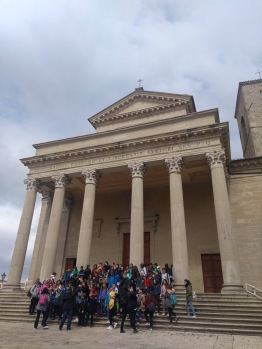 School group in front of columns