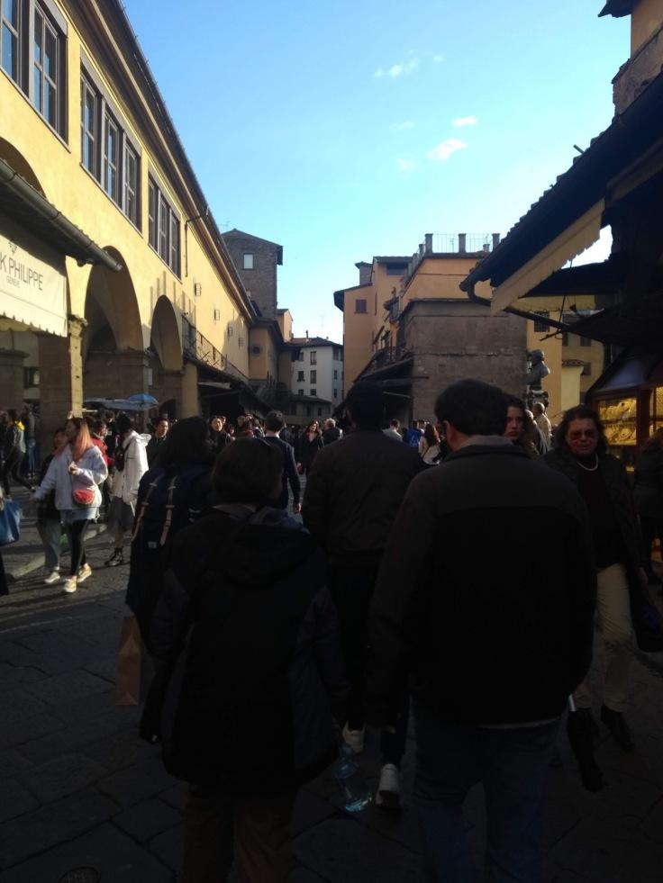 Crowds walking across the Ponte Vecchio