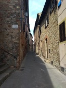 Narrow alley with brick houses, Gambassi Terme