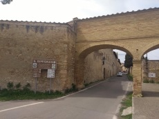 One of the city gates, and a S. Gimignano sign