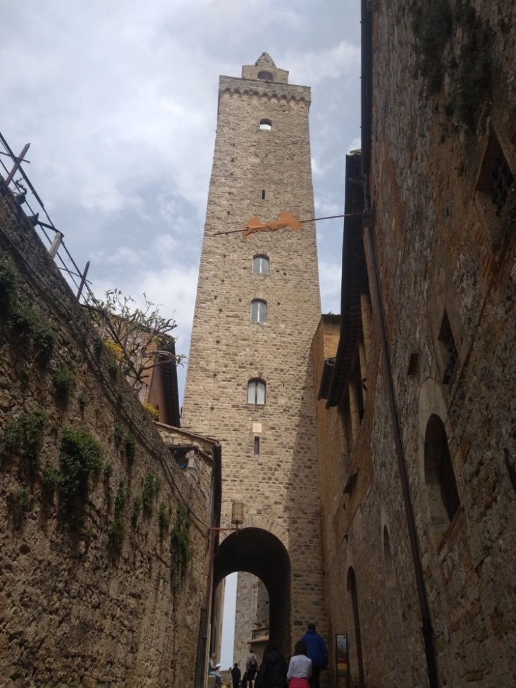 Tall tower with high arch underneath