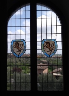 View through a window; centre is stained-glass with a horse
