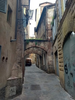Consecutive archways on a narrow street