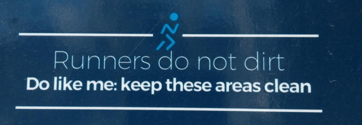 """Runners do not dirt. Do like me: keep these areas clean"", sign"