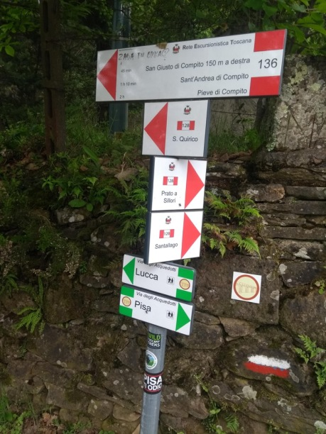 Multiple signs to local points, Lucca and Pisa