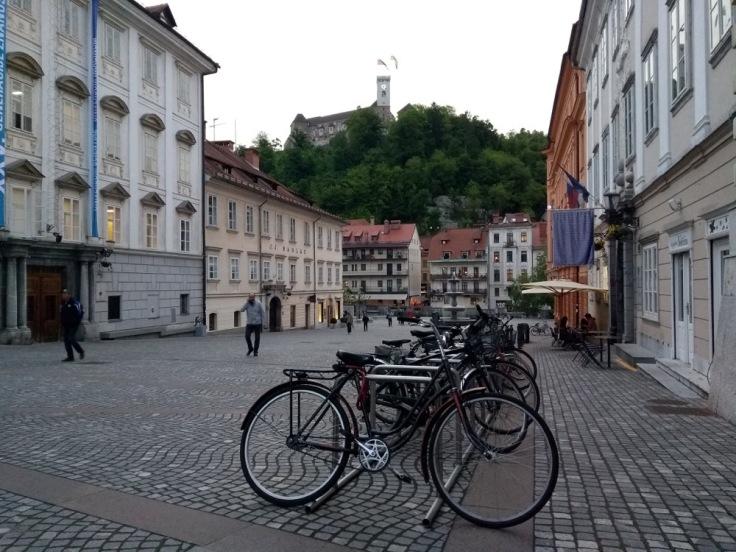 Bikes in Ljubljana, overlooked by the castle, or 'grad'