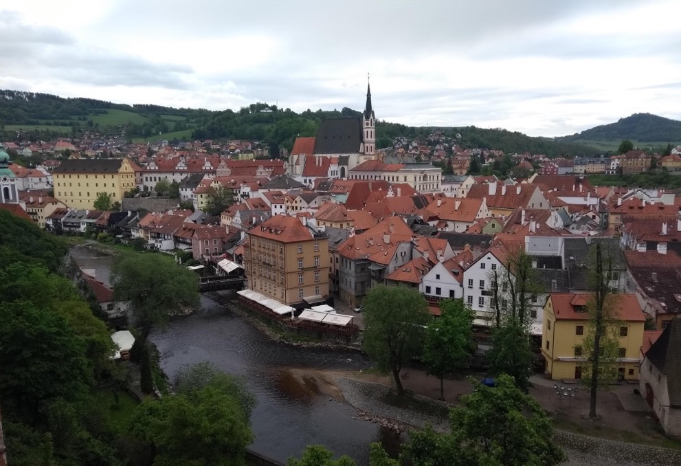 Cesky Krumlov; river wending between red-roofed buildings