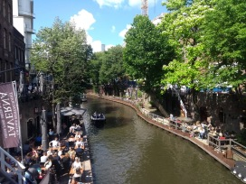 Canal lined with eateries and trees
