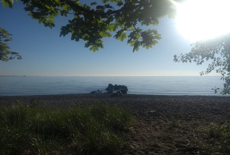Beach, rocks, then Lake Ontario stretches away