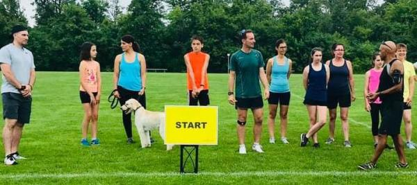 Nautical parkrun start line, 11 people and a dog