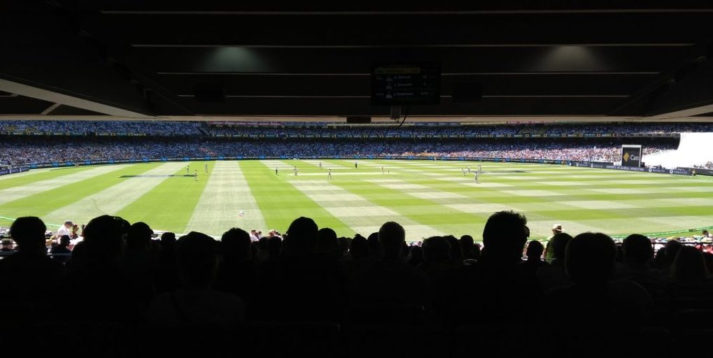 Narrow view of cricket, back of a covered stand
