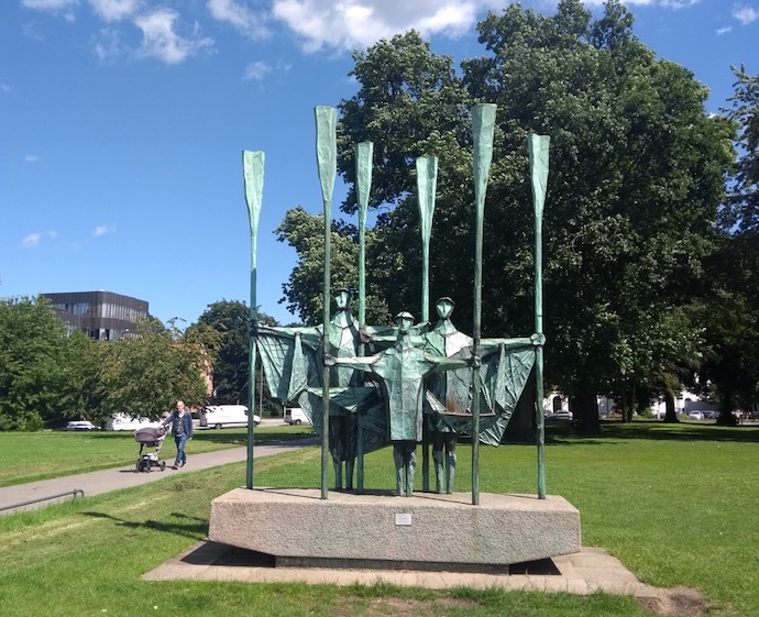 Sculpture of rowers in a park