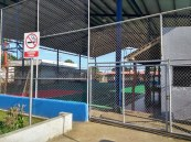 Chain fence guards the covered sports pitch